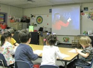 Small group watches and writes with The TV Teacher alphabet beats handwriting program